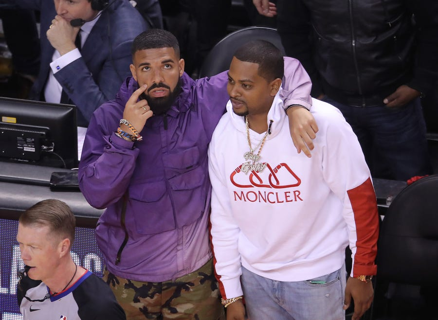 May 19: Drake watches from the sideline during the Toronto Raptors' Game 3 against the Milwaukee Bucks.