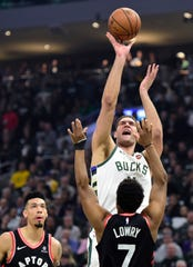 Milwaukee's Brook Lopez and Toronto's Kyle Lowry are among the growing number of NBA players who are taking their three-point shooting to another level.