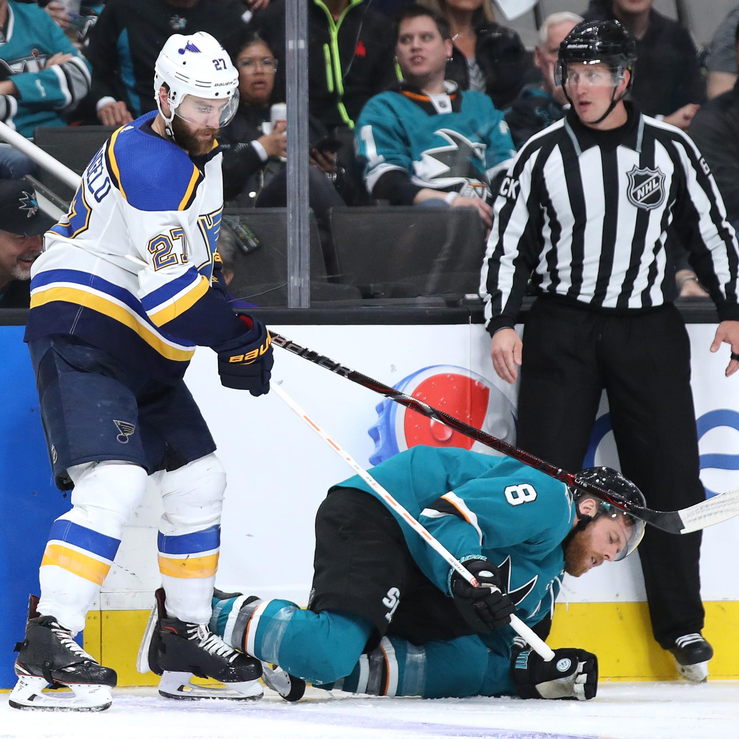 Sharks center Joe Pavelski lies on the ice after a hit by Blues defenseman Alex Pietrangelo.