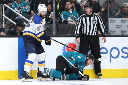 Sharks center Joe Pavelski lies on the ice after a hit by Blues defenseman Alex Pietrangelo.