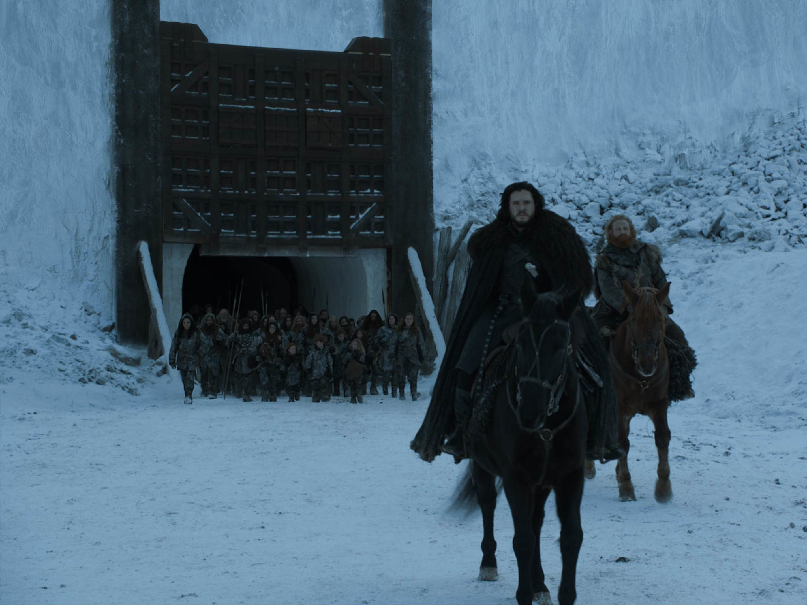 Jon Snow (Kit Harington), left, and Tormund (Kristofer Hivju) lead the wildlings back to their home north of the Wall.