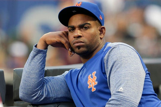 Yoenis Cespedes watches a 2018 game from the dugout.