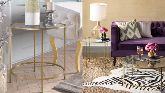 Class up your living room with a gold and glass table.