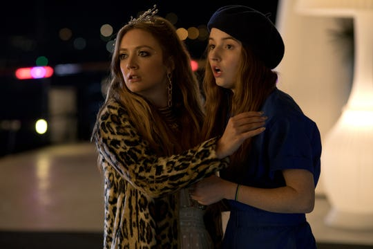 "Gigi (Billie Lourd, left) is a gonzo rich girl who has an affection for Amy (Kaitlyn Dever) in ""Booksmart."""
