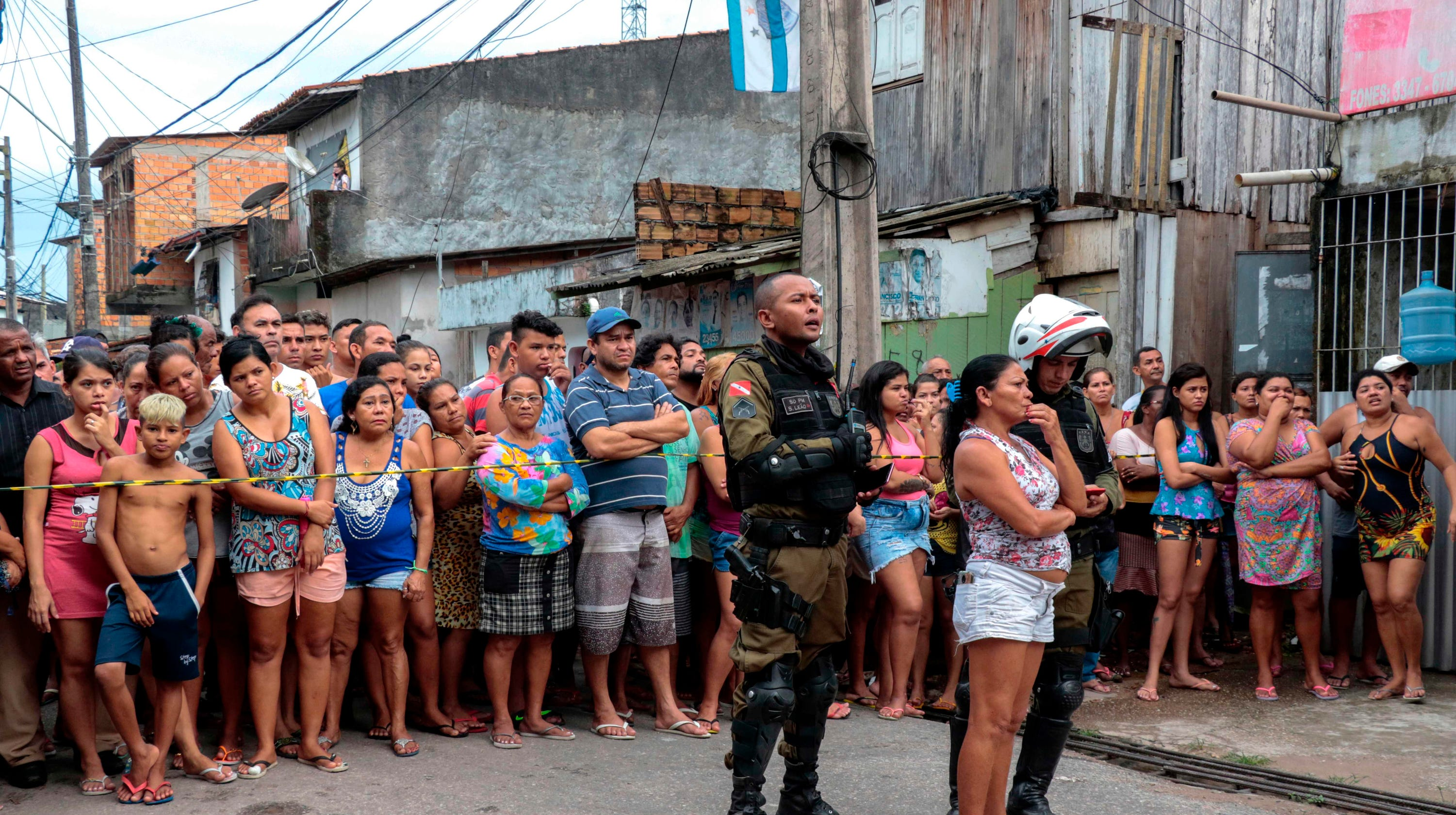 Brazil officials report 'massacre'; media say 11 dead at bar