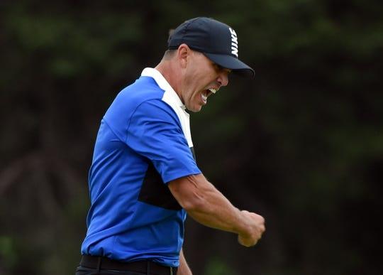 Brooks Koepka celebrates after winning the PGA Championship.