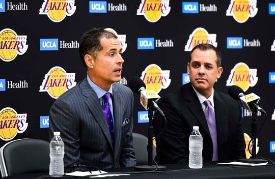 Lakers general manager Rob Pelinka, left, introduces new head coach Frank Vogel to the media at Monday's press conference.