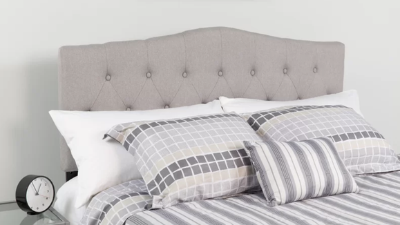 This simple headboard will give a major upgrade to any bed.