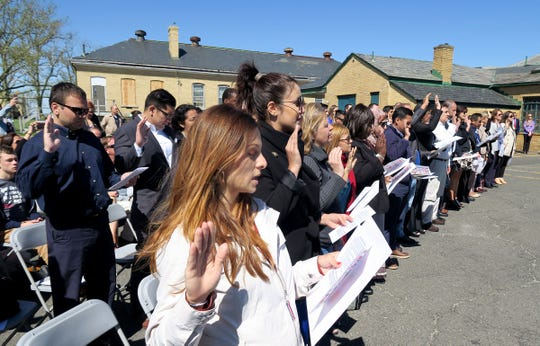 New citizen Maria Grant, Long Branch, takes the naturalization ceremony  oath along with 51 other candidates at the Sandy Hook Lighthouse in Gateway National Recreation Area Tuesday, May 21, 2019.  She was originally a Bulgarian citizen.