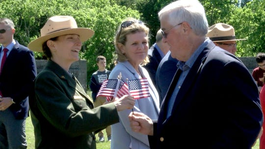 Jen Nersesian, superintendent of the Gateway National Recreation Area, presents a US Flag to new citizen Ken Wignall, Spring Lake Heights,  after a naturalization ceremony for 52 candidates at the Sandy Hook Lighthouse in Gateway National Recreation Area Tuesday, May 21, 2019.