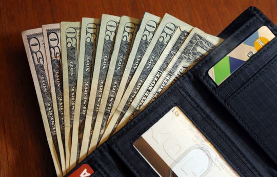 Cash is fanned out from a wallet in North Andover, Mass. Only 33% of American adults follow a budget, according to an October 2017 survey of Americans from NerdWallet . The time and effort involved are often cited as the reasons, but trying and failing is also a barrier.