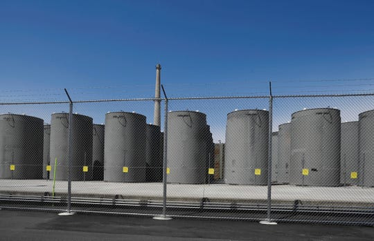 This April 29, 2019 photo shows the Independent Spent Fuel Storage Installation (ISFSI) area at Vermont Yankee Nuclear Power Station in Vernon, Vt. In January, privately held NorthStar Group Services completed the purchase of Vermont Yankee from New Orleans-based Entergy after federal and state regulators approved the sale of the reactor, closed since 2014. It marked the first permanent transfer of an operating license to a nuclear cleanup specialist for accelerated decommissioning. (AP Photo/Jessica Hill)