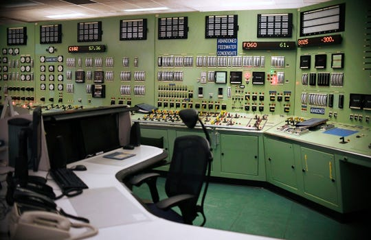 This April 29, 2019 photo shows the abandoned control room, no longer in operation at Vermont Yankee Nuclear Power Station, in Vernon, Vt. In January, privately held NorthStar Group Services completed the purchase of Vermont Yankee from New Orleans-based Entergy after federal and state regulators approved the sale of the reactor, closed since 2014. It marked the first permanent transfer of an operating license to a nuclear cleanup specialist for accelerated decommissioning. (AP Photo/Jessica Hill)