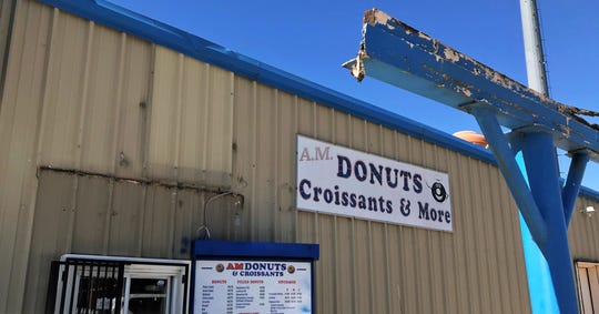 The exterior of AM Donuts on South Willis Street held up pretty well during Saturday morning's tornado, though the canopy at the drive-up window was blown away. A cellphone tower, seen in the background, was not toppled. May 21, 2019