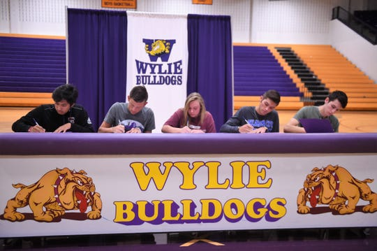 Five Wylie athletes made college plans official at a signing ceremony in Bulldog Gym on Tuesday, Golfer Phillip Hurtado, tennis players Davyn Williford and Mandy Roberson and track athletes Hayden Keidl and Kamron Rosas were honored for taking the next step in their athletic and academic careers.