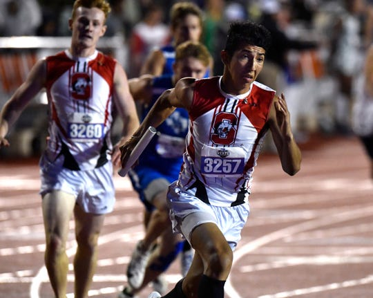 Sonora's David Delgado runs hard, having just received the baton from Wilson Johnson during the Boys Class 3A 4x400 Meter Relay at the UIL State Track & Field Championships in Austin Friday May 10, 2019.