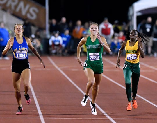 Blanco's Asher Haack, Wall's Jayden Fiebiger, and Dallas Madison's Tashia Bell compete in the Class 3A Girls 400 Meter Dash at the UIL State Track & Field Championships in Austin Friday May 10, 2019.