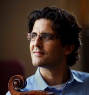 Cellist Amit Peled at the Peabody Conservatory of Music with his cello, a restored 1733 Goffriller which belonged to Pablo Casals. Peled performs with the Abilene Philharmonic on Sept. 28.