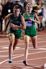Wall's Sawyer Lloyd takes the baton from Maci Beeles during the Girls Girls 3A 4x400 Meter Relay at the UIL State Track & Field Championships in Austin Friday May 10, 2019.