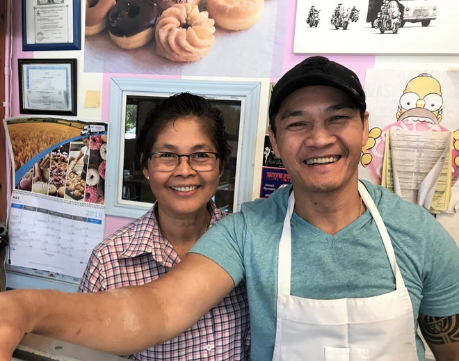 Setha Kim Dam and her brother, Anthony Kim, were glad their business, AM Donuts and Croissants, was open again Sunday following Saturday's tornado dashed by their South Willis Street shop. May 21, 2019