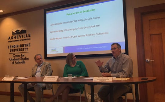 From left: Keith Wayne, president and CEO of Wayne Brothers Companies; Corie Hackney, HR manager at the Omni Grove Park Inn; and John Oswald, president and CEO of Mills Manufacturing, during a May 21 forum on immigration and the local workforce at the Asheville Area Chamber of Commerce building.
