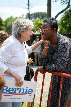 Shirley Teter speaks to former Ohio state Sen. Nina Turner as Bernie Sanders takes the stage during a rally at Salvage Station May 17, 2019 in Asheville.