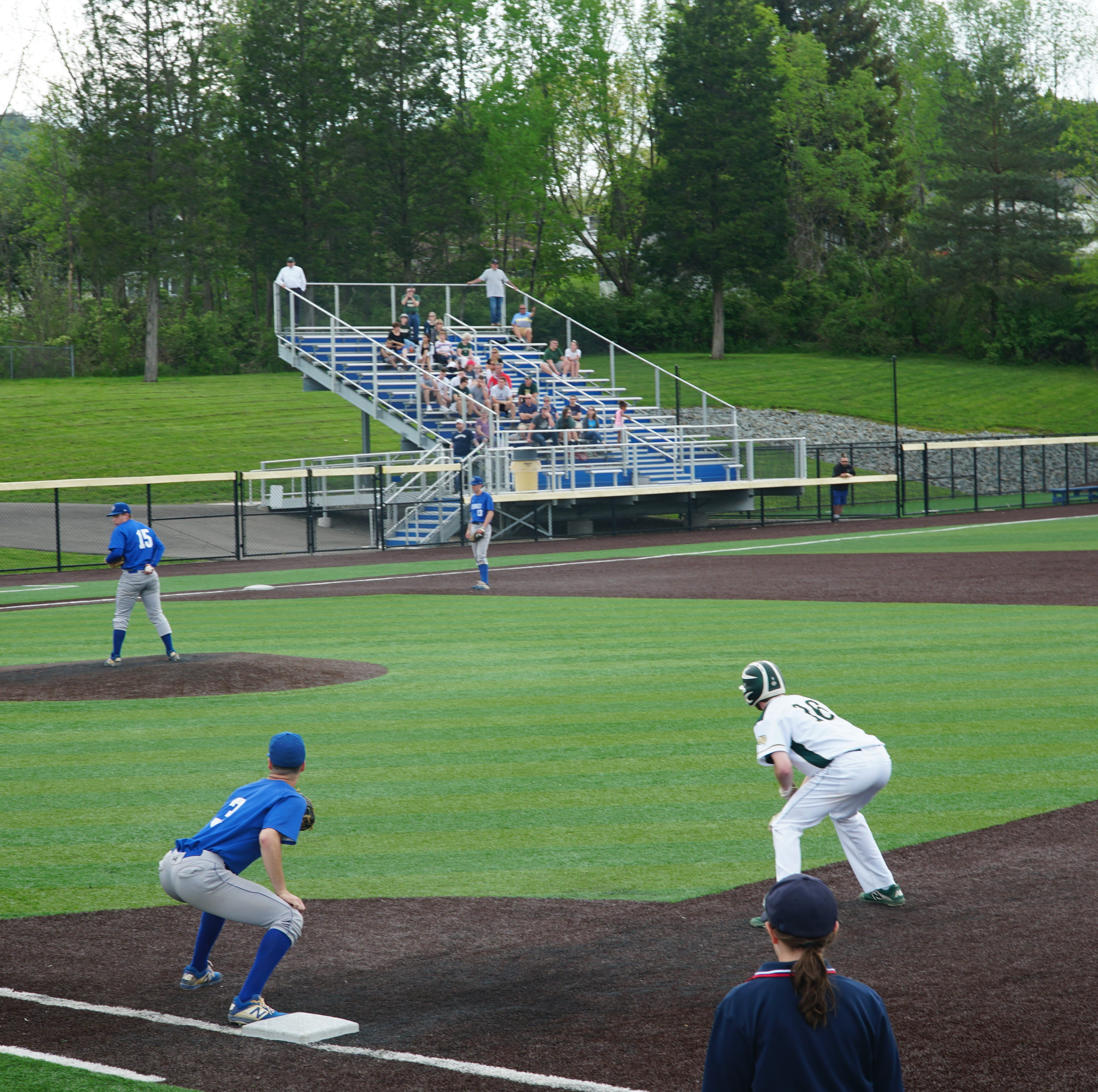 Horseheads' Elijah Schooley looks for a sign as first baseman Mike Limoncelli holds Vestal's Derek Avery in the fourth inning of Monday's Southern Tier Athletic Conference final at Maine-Endwell. Schooley threw a four-hitter in the Blue Raiders' 2-0 victory.