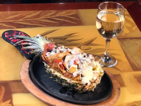 Piña Loca at Hacienda Mexican Restaurant in Binghamton is a half pineapple stuffed with chicken, steak, shrimp, grilled vegetables and shredded grilled cheese melt. It's served with guacamole salad, rice, beans and tortillas.