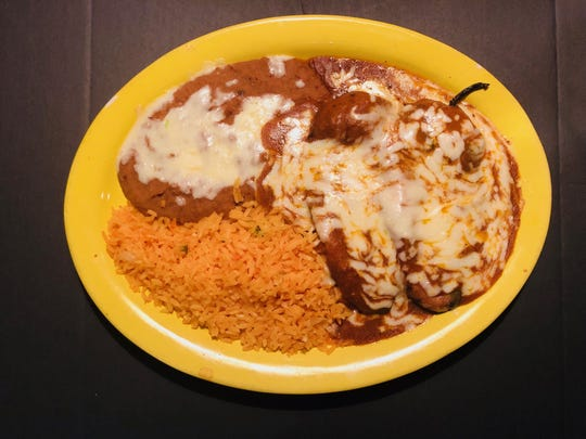 Chile poblanos at Hacienda Mexican Restaurant in Binghamton are two cheese filled poblano peppers friend in an egg batter, topped with ranchera sauce, and served with refried beans, rice and tortillas.