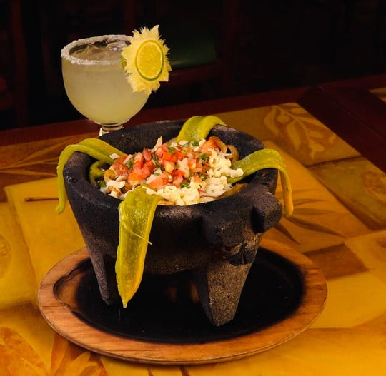 Volcán at Hacienda Mexican Restaurant in Binghamton consists of steak, chicken and  shrimp cooked with tomato, onion and cactus with special sauce, fresh cheese and a chile poblano pepper. It's served with rice, breams and two tortillas.
