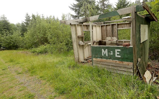 An old payment booth stands along a trail at the old M&E Christmas Tree Farm property on Bainbridge Island on Monday.