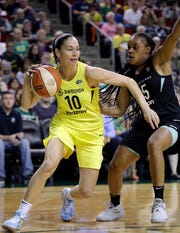 FILE - In this Aug. 17, 2018, file photo, Seattle Storm's Sue Bird (10) tries to get past New York Liberty's Brittany Boyd during the first of a WNBA basketball game, in Seattle. Sue Bird needs arthroscopic surgery on her left knee and will be out indefinitely, another big blow for the defending WNBA champs. The Storm announced Tuesday, May 21, 2019, that the 11-time All-Star has a loose body in her left knee. Bird will undergo surgery in Connecticut in the near future.