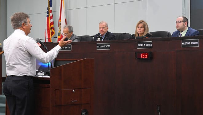 Phil Stasik, president of the Space Coast Progressive League, addresses commissioners during the public comments portion of the May 21 Brevard County Commission meeting in Viera.