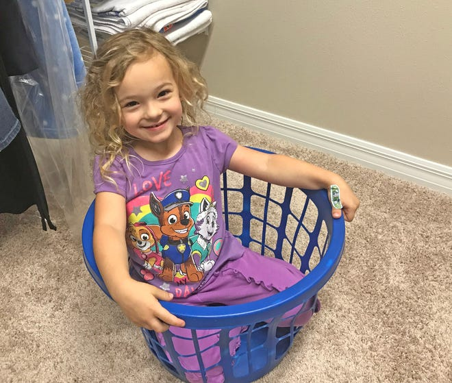 Isabella couldn't resist jumping into the empty laundry basket on a recent morning.