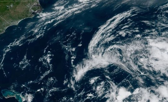 Satellite imagery shows the remnants of Subtropical Storm Andrea drifting off the U.S. east coast May 21, 2018