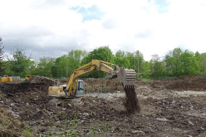 Workers from Allen Excavating in Bloomville continue grading work at the site of Bucyrus' old water plant on Monday morning.