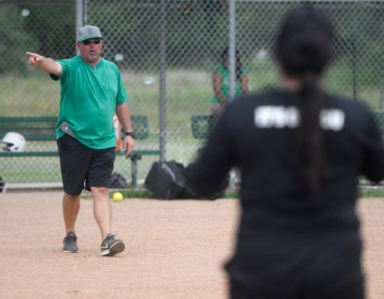 Coach Kevin Hermes speaks to his softball players during practice, Tuesday, May 21, 2019, in Banquete. Hermes is the head football coach for Banquete.