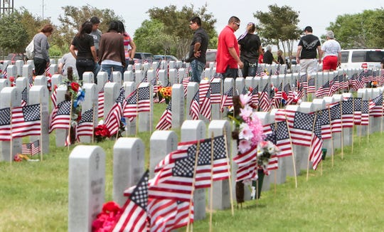 Visitors at the Coastal Bend State Veterans Cemetery in Corpus Christi on Monday, May 26, 2014.