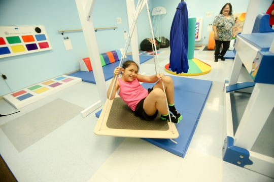 Valentina Salinas, a third grader at Robert Driscoll Elementary, swings in the new sensory room as teacher's aid Elvira Carrillo watches. School officials celebrated the new sensory room with a ribbon cutting on May 21, 2019.