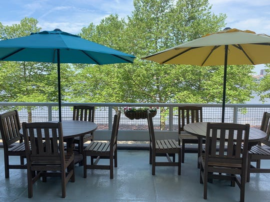 Tables with umbrellas are one of several seating options at the beer garden at Adventure Aquarium in Camden, a partnership with Flying Fish Brewing Co. of Somerdale.