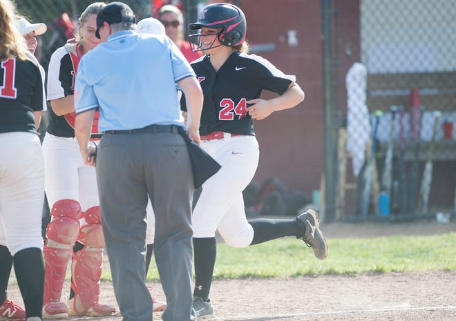 Kingsway's Tori Lipka, right, is greeted by teammates at the plate after Lipka hit a grand slam during the 5th inning of the South Jersey Group 4 quarterfinal softball game between Kingsway and Millville, played at Kingsway High School on Monday, May 20, 2019.  Kingsway defeated Millville, 8-5.