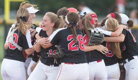Members of the Kingsway softball team celebrate after Kingsway defeated Millville 8-5 in the South Jersey Group 4 quarterfinal game played at Kingsway High School on Monday, May 20, 2019.