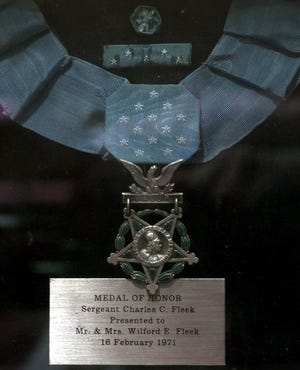 The Medal of Honor awarded to U.S. Army Sgt. Charles C. Fleek of Petersburg, Kentucky, is behind protective glass in the lobby of the Boone County Administration Building in Burlington.