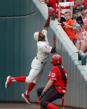 Cincinnati Reds' Yasiel Puig catches a foul ball hit by Los Angeles Dodgers' Hyun-Jin Ryu in the sixth inning of a baseball game, Sunday, May 19, 2019, in Cincinnati.