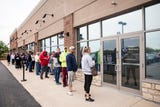 Dozens wait in line to enter the first medical marijuana dispensary in southwest Ohio.