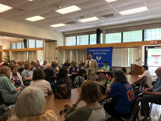 East Brunswick Mayor Brad Cohen held a Town Hall meeting to discuss the proposed redevelopment of the Route 18 corridor at the township senior center on Monday.