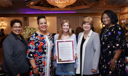 Jaimie DeDea in the center are (left to right) Union County Freeholders Rebecca Williams, Andrea Staten, Bette Jane Kowalski, and Union County Department of Human Services Director Debbie-Ann Anderson.