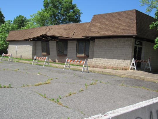 Somerville will be demolishing this former office building and restaurant on Gaston Avenue as one of the first steps of locating a police and police headquarters on the property.