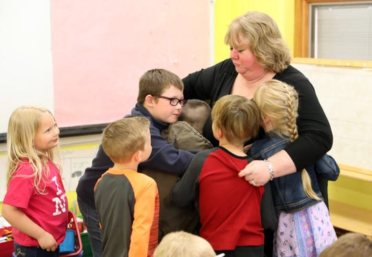 Principal Sheri Fortune gets a hug from third graders in Lindsay Lupher's third grade class at Union Elementary School.