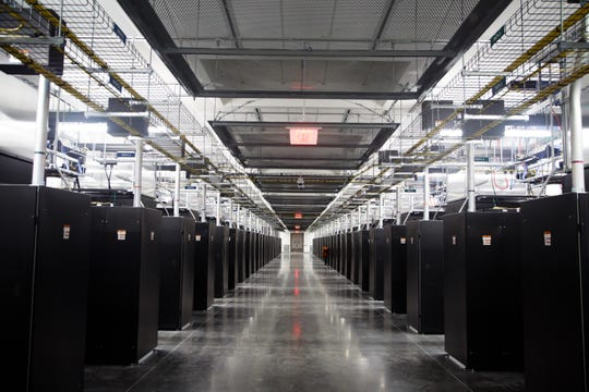 Servers line one of four data halls in the completed half of Facebook's fourth data center building. The social media company on Tuesday offered a tour of the new facility after publicly announcing plans to build a fifth building by 2022.